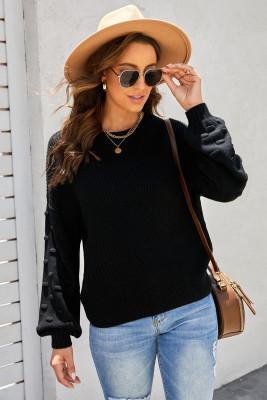 Suéter negro de punto corto con mangas de burbujas