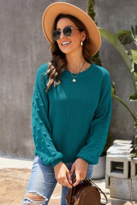 Suéter verde de punto corto con mangas de burbujas