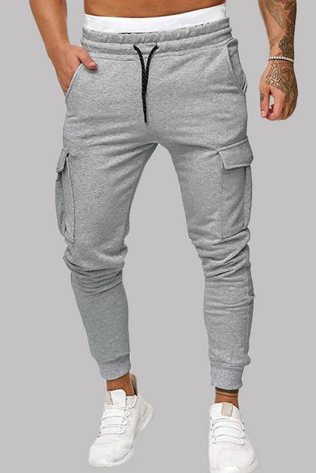 Серые облегающие джоггеры с эластичным поясом и боковым карманом на кулиске