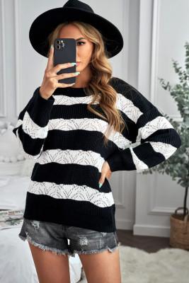 Suéter de punto a rayas negras con bloques de color