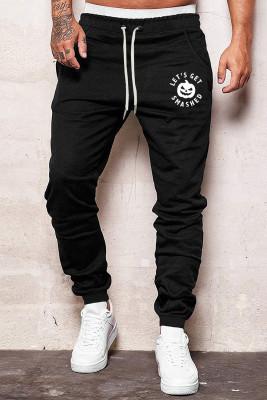 Pantalones de hombre de cintura elástica con estampado de calabaza de letra de Halloween negro