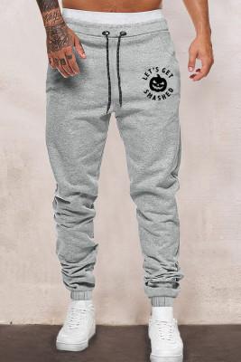 Pantalones grises de los hombres de la cintura elástica con estampado de calabaza de Halloween