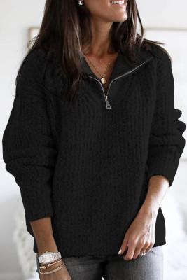 Jersey de punto negro con cremallera en el cuello
