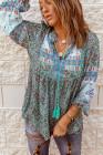 Blusa de patchwork floral con mangas de burbuja y cuello dividido