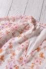 Белый топ с v-образным вырезом и длинными рукавами-фонариками с цветочным принтом
