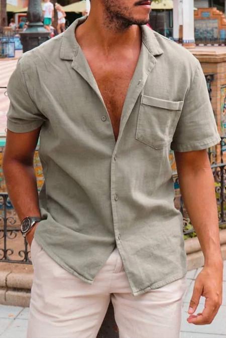 قميص أخضر بأكمام قصيرة مع جيب